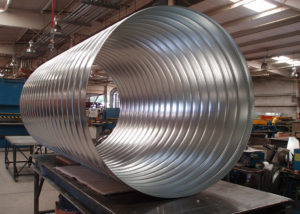 Spiral Pipe | We fabricate our own spiral pipe and fittings in both single and double wall configurations. This allows us to drastically reduce the time for fabrication and installation on your project.