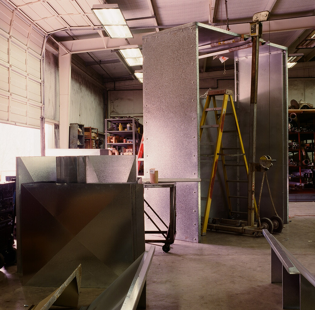 Sheetmetal Plenum | Many of our projects involve the installation of large, custom built Air Handling Units (AHRs). To attach the return air ductwork to the custom AHU, we often need to fabricate a plenum. This is an example of a fabricated plenum.
